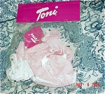 2006 Sugar and Spice Outfit for Effanbee 14 inch Toni dolls. This outfit should fit 1950s vintage P-90 Ideal Toni dolls as well. This doll outfit includes a pink with white dots dress with a double tier skirt with lace trim and pink ribbon, puffed sleeves, white panties, white socks, and white shoes. This outfit is a design from Robert Tonner after he acquired the Toni mold, and it is based on the 1950s Ideal styles for Toni. The price is for outfit only. Limited edition , old stock outfit is mint in its cellophane package. Expand listing to view the photograph and catalog picture.