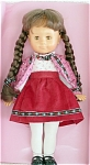 Gata Precious Gems soft vinyl Michelle doll, has a pretty, sweet face, and is 16 to 17 inches tall. She is wearing an embroidered red and pink flower print jacket, a floral on white print blouse, a cranberry red corduroy skirt, white tights, and black t-strap shoes. She has brown braids and moving brown eyes. This mint doll, has pieces of what was once part of a box, and was produced between the mid and late 1980s. Her outfit is attractive and well-made. Expand listing to view both photographs.