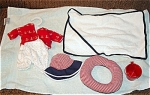 Gotz 2000 Swimming Outfit Set for 12-13 inch baby dolls. This doll bathing ensemble contains a white with red dots knit swim suit; red knit beach jacket with white anchors; red, white, and blue cloth hat; red and white innertube; red bucket; and white towel lined with dark blue. Although the package does not identify this as Sasha outfit, it fits a Sasha toddler or sitting Sasha baby doll of 12-13 inches. Retired doll outfit is mint in the cellophane package old stock. Expand listing to view of both photographs.