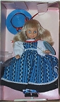 Horsman 1988-89 Melissa Seasons Fall doll, 8 inch is a soft vinyl doll, from a mold similar to Sunrise in America, has blonde rooted hair with bangs, and moving blue eyes. Her outfit includes a long blue geometric print pinafore with white lace over a black skirt, long white sleeves blouse, blue straw-like hat with red ribbon, black shoes, and plastic stand.  This discontinued doll is new, and mint-in-the-box with tag.