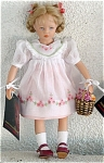 2005 8.5 inch vinyl and fabric Heidi Plusczok Francy Artist Doll. Her wig is styled in blonde looped braids topped by pink ribbon, and she has painted blue eyes. She is wearing a white cotton dress over a peach slip. The dress has short puffed sleeves, and a large front collar edged with white lace and trimmed with pink flower and green leaf embroidery, and pink floral and green leaf embroidery edging the hemline. She is wearing maroon leather-like shoes, white stockings, and white lace edge underpants. She comes with a basket of flowers. Heidi Plusczok uses only the highest quality fabrics and materials, and most superior workmanship in her dolls. This doll is perfect for Spring in this lovely outfit. New and mint-in-the-box with shipping box, includes tag with her number. Part of a limited edition of only 120. Expand listing to view both photographs and the catalog picture.