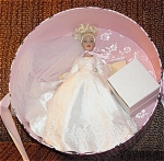 Robert Tonner 2004 Tiny Kitty Collier Forever Yours Hat Box Set, No. KT6402, 2004, 10 inch bride doll with blonde hair put up in curls and  painted blue eyes. Her bridal ensemble includes a white wedding dress with metal corona, and lacy veil. Her accessories consists of green lingerie, pearls, wedding cake. The set is boxed in a beautiful hat box with the pink floral Kitty Collier logo. Discontinued limited edition is new and mint-in-the-box. Expand listing to view all 4 photographs.