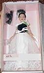 Robert Tonner Tiny Kitty Collier High Drama Doll No. KT1403, 2004, 10 inch fashion doll has brunette hair put up in curls, and painted blue eyes. She is wearing an elegant sleeveless formal evening gown with white flowers on one shoulder, a black velvet bodice, a white sheath underskirt with leaf and sequin embroidery, white net over skirt slit in front with similar embroidered sequins pattern, long black gloves, a black purse, rhinestone and sequins earrings, and white heels. A fashion doll stand is included.  Discontinued Style, limited edition. New and mint-in-the-box with shipper. Expand listing to view both pictures.