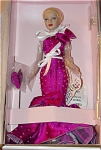 Robert Tonner 2004 No. KT 14032 Tiny Kitty Collier Enchantment Doll, is an elegant 10 inch hard plastic fashion doll with pale blonde hair in bun, and painted blue eyes. She is dressed in a beaded satin-like magenta formal evening gown with flared skirt with bow at bottom and one shoulder covered with strap and bow while other is bare and matching magenta high heels. Accessories include rhinestone earrings and necklace, stand. New and mint-in-the-box old stock. Expand listing to view all 3 pictures.