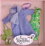 Robert Tonner 2004 Groovy Shopper Outfit is for Tiny Kitty Collier 10 inch fashion dolls. This doll outfit includes a colorful green and lavender floral print sleeveless sheath dress with bow in back, lavender cloth coat with 2 pockets and lining to match dress, lavender scarf, lavender headband with flower, white with lavender flower-style earrings, green purse, green gloves, and green cloth shoes. The price is for the outfit only. Retired limited edition is new and mint-in-the-box with shipper.