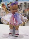Click here to enlarge image and see more about item KEW0001: Cameo Spirit of Freedom Kewpie Doll 2004