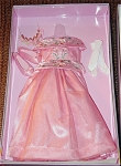 2004 Princess for a Day Fashion for 18 inch Magic Attic Club Dolls, designed by Robert Tonner, and marketed by Charisma Brands. This doll outfit includes a pink satin formal evening gown with embroidery on bodice, pink tulle slip, matching slippers, long white gloves, and golden crown surrounded by flowers.  This Magic Attic Club line of dolls and outfits has been discontinued. This well-made outfit is new and mint-in-the-box.
