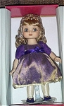 Marie Osmond 2002 15 inch vinyl Belle of the Ball, is a charming doll with giant blue eyes, dark blonde hair, and a whimsical expression. Her costume includes a lavender with gold party dress, corona, jewelry, and corsage. The doll is by Marie Osmond of Marian Ltd., formerly Knickerbocker.  New and mint-in-the-box. Expand listing to view all 3 photographs.