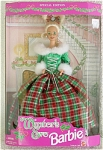 Mattel Winter's Eve Barbie from 1994. Gorgeous open mouth smiling 11.5 inch vinyl Barbie doll has blonde hair and blue-green painted eyes, and she is in a box with a decorated mantel background. She is wearing a long sparkling red and green formal evening gown with silver lace, and white fur trim on sleeves and neckline, and silver dangling earrings. This colorful Barbie is exceptional. A Costco label is on the box. New old stock, mint and never-removed from her box.