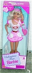 1996 Valentine Fun Barbie doll has long rooted blonde hair with bangs, blue painted eyes, and a slender body. Her Valentine's Day outfit is a short dress with white shirt with deep pink heart and pink ruffled short sleeves, and short pink skirt with small deeper pink hearts and white hearts print on pink with deep pink ruffle at hemline and white heart pockets, deep pink belt with heart buckle, matching cloth hat with sun visor, pink heart purse, white pearl earrings, white shoes, and comb and brush. This doll is like new, mint, and never-removed-from-the box.