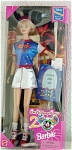 Walt Disney World 2000 Exclusive Bring Home the Magic Mattel 11.5 inches vinyl Barbie fashion Doll with long blonde rooted hair, smiling open mouth, and painted blue eyes. In her box, she is standing against a fireworks background. Her copyright is 1998. Her Disney park outfit includes a silver mini-skirt with red stitching, a deep blue shirt with a 2000 logo with Donald Duck, Mickey, Mouse, and Pluto, and outer-space print with white net short sleeves and red band trim, red and silver baseball-type hat, red tennis shoes, and white socks. Inside is a Photo Frame. On back is a map of Disney World. This Barbie is celebrating the new Millennium Disney Style. She is new, mint, and never-removed-from-her-box, though the box shows wear, so doll is listed as used.