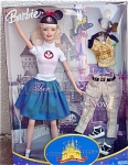 2005 Mattel Fifty Years Disney Theme Park Barbie Doll. 11.5 inch slender vinyl Barbie fashion doll has long straight blonde hair, painted blue eyes, and an open mouth. Her 1955 Disney outfit includes a blue pleated corduroy skirt, white tee-shirt with Mickey Mouse Club motif, black mouse ears with red bow and picture of Mickey Mouse, white socks, and black buckling clogs. Included with her is a 2005 casual outfit consisting of tan jeans with leg pockets, belt, yellow tee-shirt with castle and Tinkerbell picture that says 'Golden Celebration', mouse ears with golden ears and golden mouse face that says '50', black and white tennis shoes, a Tinkerbell picture, and hair brush. The background of the box shows the Sleeping Beauty castle at Disneyland. Very special Barbie doll was sold at theme parks during Disneyland's 50-year celebration. New, mint, and never removed from the box. Expand listing to view both photographs.