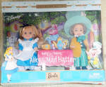 Mattel Kelly and Tommy 4.5 inch girl and boy dolls as Alice in Wonderland and the Mad Hatter from 2002 as represented in the Disney movie. Alice has long blonde rooted hair with a black ribbon, painted blue eyes, and a closed mouth. She is wearing a blue dress with white pinafore, blue and white striped socks, and black Mary Jane shoes. Tommy as the Mad Hatter has platinum blonde hair under a giant aqua hat with 10/6 on it,  aqua and gold striped pants, an aqua vest, aqua with white polka dots bowtie, gold coat, and aqua shoes. The dolls come in a box with a Wonderland backdrop with the Cheshire Cat, a fold-out table with a plastic teapot and tea cup. There is a synopsis of the setting on back of the box. These dolls are mint, and never-removed-from box old stock. However, there may be minor dents on the bottom of the box or on the side.