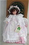 14 inch Pittsburgh Originals vinyl Vanya Summer Angel doll from the Winds of Change collection of Chris Miller from approximately 1996. This doll has a sweet child's face, brown hair with a floral hair wreath and painted brown eyes. This is the same face that was designed and used when the company was under Robin Woods.  Vanya is dressed in a white over pink gown with white feather-like wings. Robin Woods also used this doll sculpt. Vanya comes with an adjustable metal stand and certificate. Retired limited edition of 2,500.Mint-in-the-box old stock. Expand listing to view the 2 photographs and catalog picture.