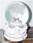 Musical Ivory Carousel Water Globe is a white ceramic horse inside a glass water globe; the base is ivory off-white and gold bisque decorated like an old carousel. The water globe plays the theme heard on carousels. It measures approximately 5 to 6 inches in height. It comes from the middle to late 1990s. The exact date of its production is unknown. In new and mint condition. Expand listing to view both photographs.