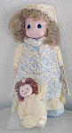 Precious Moments Company 16 inch vinyl and cloth Dawn doll in Night Gown with Rag Doll, No. 1057, 1993-1996 is retired. The large doll has curly blonde hair, painted blue tear-drop shaped eyes, and a smiling face. She is wearing a blue and cream nightgown, a matching night, and blue slippers. Her little cloth rag doll has red yarn hair and a yellow nightgown. Retired old stock doll set is in new and mint condition and includes a gift box. Expand listing to view all 4 photographs.