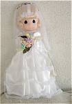 Precious Moments Company 16 inch vinyl and fabric Jessi Bride Doll No. 1001 from 1989, was retired in 1998.  This bride doll has blonde hair styled in a ponytail with side curls covered by a veil, painted blue teardrop-shaped eyes, and a smiling face. Her wedding costume includes a long white dress with a beautiful satin over-skirt, and lacy veil. She is holding colorful pastel silk flowers. New old stock with doll in mint condition doll with a gift box which shows its age. Expand listing to view both photographs.