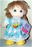 Precious Moments Company 7 inch blue and yellow plaid all-cloth girl rag doll is a mini doll who has tan yarn hair, blue screened teardrop shaped eyes, and a smiling face. Her outfit includes a blue and yellow plaid dress, yellow shoes, red plaid bow, and red heart. Doll was introduced in 1995 and discontinued in 1996. New and mint condition.