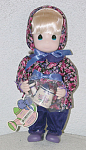 Precious Moments Company 12 inch Jasmine January Garden of Friends doll, from 1995 2nd Edition, No. 1425, has pale blonde rooted hair, painted blue teardrop-shaped eyes, and a smiling face. She is wearing purple winter pants, a floral pink and purple print jacket and matching hat, and purple shoes. She is holding a watering can with her month and her name and has a watering can-shaped hang tag. Retired from limited edition of 15000. Mint condition old stock. Expand listing to view both photographs.