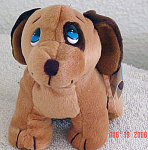 Precious Moments Company Dudley, the tan and brown Dog from the First Edition of Bean Bag Pals (called 'Beanie Pals') that were produced in 1997 and retired in April, 1998. His tag's verse says: 'Is loving and thoughtful, too, Making sure all your Wishes come true!' He is a brown and darker brown dog with blue stick-on teardrop shaped eyes. He is comparable in size to Ty beanies and small Enesco Tender Tails at approximately 7 to 8 inches in size. The Dudley puppies sent to me have darker brown circle around left eye, but other variations are possible. Old stock plush is mint with his tag. Expand listing to view both photographs.