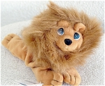 Precious Moments Company Alek the Lion tan lion with thick mane Bean Bag Pal plush (originally called 'Beanie Pals'). He is part of the second (2nd) edition of bean bag Pals. He was introduced in 1998, and retired in August, 1999. Alek has blue and white stick-on teardrop shaped eyes, and he is 7 to 8 inches in length. Old stock is mint with tag.