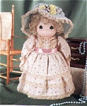 Precious Moments Company vinyl and cloth 16 inch Charity No. 1127 doll, was issued 1998, and  retired 2000. She has a vinyl head with dark blonde curly rooted hair, painted tear-drop shaped eyes, and a smiling face. She is wearing a long cream and pink triple-tier floral dress with matching cloth hat trimmed with flowers and lace. Retired, new, mint condition with gift box. Expand listing to view the catalog picture and both photographs.