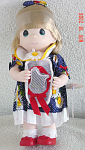 Precious Moments Company 1997-1998 third edition Garden of Friends 12 inch vinyl and fabric Sunny, September doll. She has dark blonde rooted straight hair with a small top ponytail with bangs and hair bow that matches her dress, and painted green teardrop-shaped eyes. She is wearing a dark blue with white dots and white and yellow sunflower print dress with a sunflower on her collar and white hemline ruffle, lacy white socks, and red shoes. She is holding her white open-weave hat. These older dolls did not come with boxes. Retired limited edition doll is in new and mint condition, and she has her tag.