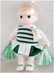 Precious Moments Company 12 inch vinyl and cloth cheerleader in green and white doll issued in 1998. Her blonde rooted hair is styled in a ponytail; and she has painted blue teardrop-shaped eyes, and a smiling face. Her cheerleader costume consists of a green and white skirt over white shorts, a green and white striped vest over white shirt, white socks and white with green sneakers. She is holding green and white streamers and a white megaphone with green letters that say 'PM'. Retired doll is new and mint.