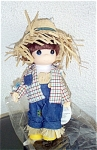 Precious Moments Company 1998 9 inch 'You're Too Cute to Be Scary' Boy Scarecrow vinyl doll, No. 1560, has brown rooted hair, painted blue teardrop-shaped eyes, and a smiling face. He is wearing a big straw hat, blue denim jeans, a white tee-shirt, a plaid shirt, and has straw sticking out at his waistline. This scarecrow is sure to melt hearts rather than frighten anyone. He is ideal for Halloween, or any Fall celebrations. Mint condition old stock. These did not come with boxes. Expand listing to view both photographs.
