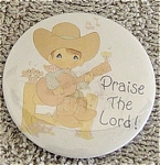 Precious Moments Company Praise the Lord! Round Metal Refrigerator Magnet from the late 1990s. This magnet's artwork depicts a boy wearing a cowboy suit singing as he plays the guitar. Inquire about lower insured First Class Mail shipping for small orders in comments section of order form. Old stock in mint condition.