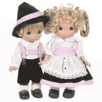 Precious Moments Inc. 2012-2013 All Vinyl 9 inch Gretchen girl, No. 3492 and Gunther boy of Germany dolls, No. 3493, are from the Children of the World collection, which is based on the Song Jesus Loves All the Little Children of the World. Their costumes match.  She has rooted blonde hair styled in a looped braids with green ribbons and red and green flowers and and front curls under blue teardrop shaped eyes, and a smiling face.  He also has blonde hair and blue eyes. She is wearing a black, white, and pink Bavarian style dress with a white eyelet and lace trimmed apron, white socks, and black shoes. He is wearing is wearing black short pants, pink suspenders, a white shirt, a black felt hat with pink band, white socks, black shoes.  This is a Linda Rick of Doll Maker Design. New and mint with a gift boxes