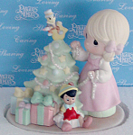 Precious Moments, Inc. c. 2006 The Art of Disney porcelain bisque figurine, 'When You Wish Upon a Star', No. 690010D, is 6 inches tall. This figurine depicts a blonde Precious Moments Girl with brown teardrop-shaped eyes wearing a pink dress who is decorating her Christmas tree with a darling little Jiminy Cricket sitting on the star and Pinocchio under the tree among the gifts. This figurine is from the Showcase Art Shop inside Disneyland's Anaheim, California Theme Park. New, Mint-in-the-box. Expand listing to view all 3 photographs.