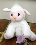 Enesco Tender Tails Precious Moments bean bag plush white lamb  from the second edition of Tender Tails Bean Bags in 1997 and is retired. This soft white lamb has embroidered black eyes, a yellow nose and smiling pink facial features and feet, and is 8 inches in size. Has faint dots on end of seam lines on face that are more like factory needle marks, has tag; have listed as used though actually has been buried in storage and never owned by anyone else. Click to expand listing for the best view of the photograph.