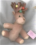 This tan reindeer bean bag is from the first holiday limited edition of Tender Tails Bean Bag Plush by Enesco of Precious Moments characters. This brown Christmas holiday reindeer has a smiling face and embroidered black tear drop-shaped eyes. It is 8 inches in size. Red, green, and yellow pompoms decorate its antlers. This style is not suitable for small children because of the colorful pompoms that can come off. It is best for collectors or holiday decorations. This festive reindeer was made in late 1998 and is retired. He is new and mint with tag.
