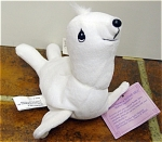 Enesco Tender Tails Precious Moments White Harp Seal Bean Bag Plush is from the first Christmas holiday and winter-themed edition of Tender Tails Bean Bags in 1998. This white plush seal has embroidered teardrop-shaped black eyes, smiling black facial features; and is about 8 inches long. New old stock that is mint with its tag.