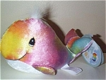 This colorful multi-pastel colored rainbow whale beanbag plush is from a limited edition of Tender Tails Bean Bags by Enesco of Precious Moments characters and is 7 to 8 inches in length. This multi-toned plush whale has black embroidered tear-drop shaped eyes and a smiling face. It was marketed in 1999 and is now retired. This is part of a series of whales of a variety of colors from a promotion when different shops had different colors of whales. Retired, new, and mint with tag. Expand listing to view both photographs.