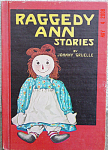 The hardcover book, Raggedy Ann Stories, was written and Illustrated by Johnny Gruelle, reprinted in 1961. The book was copyrighted in 1918 and 1947. It is complete with its original color and black-and-white drawings, 95 page, and it is in excellent condition; the only noticeable marks are faint yellow spots on page edges and erased marking on inside cover page. It contains charming stories of Raggedy Ann, Marcella, and the other dolls, and this first book tells of Raggedy Ann's arrival to live with Marcella and win her heart. It has stories of Raggedy Ann, Marcella, Marcella's family, and the other dolls and toys in the nursery. The dolls and toys come to life whenever Marcella and her family are away or asleep. This reprint was published before books had ISBN numbers.  Expand listing to view both photographs.