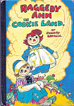 Hard Cover Book, 'Raggedy Ann in Cookie Land', written and Illustrated by Johnny Gruelle, The Bobbs-Merrill Co., Inc., Copyright 1931, printed in 1960, and contains 95 pages. This book tells a story of the Raggedy dolls, who fall in a hole and hit the bottom without damage because of their cotton-stuffed bodies. Then they discover they are in an ice grotto from which they escape to Cookie Land which is a lovely place that fills Raggedy Ann's candy heart with joy. Hookie, the mean goblin makes problems for Raggedy Ann and Raggedy Andy and their new friends until there is a last-minute rescue. The dolls and toys come to life whenever Marcella and her family are away or asleep. The book has wonderful original color and black-and-white drawings as were in the original editions.  Pre-owned, excellent, has all pages and cover, is tightly bound.