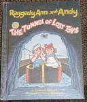 Raggedy Ann and Andy in the Tunnel of Lost Toys is a used hard cover book by Catharine Bushnell and illustrated by Vernon McKissack that is in the spirit of the creator, Johnny Gruelle. This book is the Weekly Reader Children's Book Club edition from 1980 that was published by The Bobbs-Merrill Co., Inc. It has 36 pages in larger easy-to-read print and is illustrated with charming color drawings very much like the original artwork of Johnny Gruelle. In the interesting story Raggedy Ann and Andy get lost during a tunnel ride with Marcella, and join many other lost toys that a scary dragon snatched from children during the ride. They had to dream up an escape for themselves and the other toys. Book is used but in excellent condition except for minor fraying of the edges. All pages are intact and it is tightly bound. The only marking is penciled original price on the first front inside page. Excellent, used condition old stock. The ISBN nos. are ISBN-10: 0672526336 and ISBN-13:9780672526336.