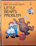 This listing is for the hard cover book, Little Bear's Problem, Volume 2 in Raggedy Ann and Andy's Grow-and-Learn Library. It has 44 pages with large print and color illustrations on each page. This was copyrighted by Macmillan, Inc. in 1988, and published by Lynx Books. The characters and drawings are based on the creations of Johnny Gruelle.  The book is preowned and only gently used; it has a child's name written in the This Book Belongs to section. Other than that, there are no markings and the condition is excellent. The book is meant for a young child to read, though it is also good to read to a child. Little bear was upset that his parents worked at the circus and Raggedy Ann and Andy taught him to appreciate them and their tricks. When the people are away the dolls, stuffed animals, and young animals come to life and talk and interact with one another in drawings like classical ones. The ISBN numbers are ISBN 13: 9781558021211 and ISBN 10: 1558021027.  Expand listing to view both photographs.