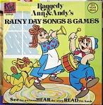 Softcover Storybook, Coloring Book and Small Size 33.33 rpm Record Set, 'Raggedy Ann and  Andy's Rainy Day Songs and Games', Bobbs-Merrill Company and Kid Stuff Records, 1980. This does not have an ISBN. The coloring book, which is in excellent condition, contains 16 pages. Its black and white pictures are intended to be colored. We have not tried to play the record. Because the record has some visible light scratches on both sides, this set is available at a reduced price. A note with the set says that the record narrates the book. The book and record's story contains the songs: 'The Farmer in the Dell', 'Little Bo Peep', ' Mary Had a Little Lamb', and 'Ring Around the Rosy.'  Raggedy Ann and Raggedy Andy are loveable rag doll characters created by Johnny Gruelle. This book was pre-owned by a serious collector and is a great addition to a collection or wonderful entertainment for children. The used book is in very good condition except for the noted flaw.