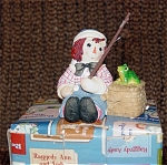 Enesco Raggedy Andy Bisque Resin Figurine No. 677809 with Fishing Basket box with Frog on Lid. The title is 'Joy and Love Are Truly Catching'. This figurine depicts the lovable personality of Raggedy Andy who is dress in his classic sailor-style red, white, and blue outfit and fishing. The date is not given, though it most likely is from the 1990s. New, mint-in-the-box  with tag from Enesco's Raggedy Ann and Raggedy Andy collection.