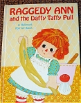 Hallmark Hard-cover Pop-Up Raggedy Ann Book, 'Raggedy Ann and the Daffy Taffy Pull', written by Dean Walley, Illustrated by Marianne Smith, copyrighted in 1972 by Bobbs-Merrill Company and 1972 by Hallmark Company. Johnny Gruelle originally created the lovable, happy rag doll character, Raggedy Ann. This book has 12 pages with charming color illustrations. All moving illustrations are in working condition. They either pop up or move when a tab is pulled. This gently used book, is in excellent condition. The book's only noticeable flaw is the name of a previous little owner is written inside. Otherwise the book is in outstanding condition for its age. It is perfect for either a young child or a Raggedy Ann and Andy collector. The ISBN nos. are ISBN 13: 9780875292809 and ISBN 10: 0875292801.  Expand listing to view all 3 photographs.