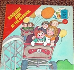 Click here to enlarge image and see more about item RGR0003: Raggedy Ann at the Carnival, Paperback Book 1977