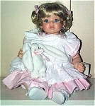 Click here to enlarge image and see more about item SWN0002: Susan Wakeen Cindy Baby Doll with Bunny 1994