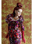 2011 16 In. Tonner Delightful Antoinette Fashion Doll, No. T11FMDD07 has auburn rooted saran hair that is long and straight in the back with a top ponytail; painted blue eyes with painted lashes with heavy makeup; natural soft pink lipstick, multiple joints for posing; and Tyler skin tone. She has the same high quality hard plastic and vinyl body type as Cami and Jon with the higher arched feet, and she can share clothing with them. Her ankles, wrists, and knees are jointed. She is wearing a deep purple, red, orange, and burgundy floral tailored suit Jacket with matching skirt; black tights, burgundy high heel pumps  