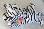 Ty, Inc. Blizzard the black and white Tiger beanie baby plush, No. 4163, is approximately 7-8 inches in size, and her day of birth is December 12, 1996. Freckles was introduced on May 11, 1997 and retired May 1, 1998. This beanie represents a rare tiger in real life. Blizzard's verse is: 'In the mountains where it is snowy and cold, Lives a beautiful tiger, I've been told, Black and white, she's hard to compare, Of all the tigers, she's the most rare!' Retired and mint with tag, has not been exposed to smoke or unpleasant odors.