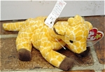 Ty, Inc. Style No. 4068, Twigs the yellow and brown Giraffe plush. This Beanie Baby's day of birth was  May 19, 1995.  Twigs was introduced January 7, 1996, and retired May 1, 1998. Twigs' verse is: 'Twigs has his head in the clouds He stands tall, he stands proud With legs so skinny they wobble and shake What an unusual friend he will make!' Twigs is approximately 7 to 8 inches long, is like new and mint with tag and has not been exposed to smoke or unpleasant odors. Expand listing to view both photographs.