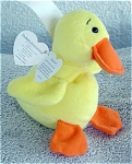 Ty, Inc. Quackers the Yellow Duck with Wings, No. 4024, retired Beanie Baby plush. This little duckling's birthday is April 19, 1994. Quackers was introduced January 7, 1995, and retired May 1, 1998. The size is between 7 an 8 inches. The verse on Quacker's tag is: 