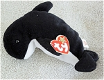 Ty, Inc. Retired Waves the Black and White Whale beanie baby plush, No. 4084, is in new, mint condition with the correct tag. Waves' birthday is December 8, 1996. Waves with the correct tag was introduced on May 11, 1997, and retired on May 1, 1998. Waves is 7 to 8 inches in size, and has not been exposed to smoke or unpleasant odors. The verse on Waves' tag is: 